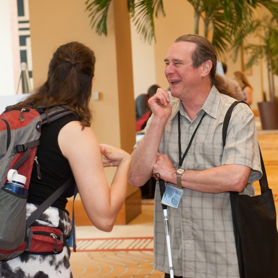 Photo of two LEAD attendees speaking to each other from the 2014 conference.