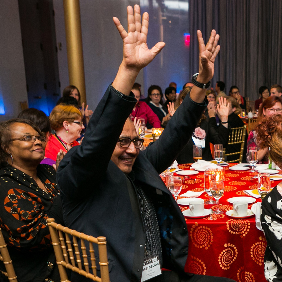 Photo of attendee cheering at the 2013 LEAD Awards Dinner at the Kennedy Center.