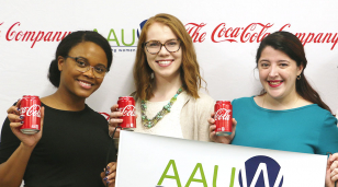three participants from the AAUW empower event holding cans of coca-cola, an AAUW partner